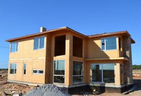Двухэтажный сборный дом из СИП панелей